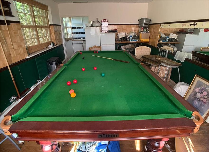28531650-8331367-One_of_the_rooms_has_a_huge_snooker_table_left_abandoned_with_th-a-51_1589810556853