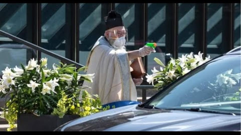 Michigan priest goes viral after using holy water squirt gun during drive-thru service