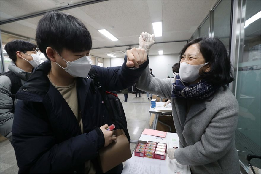 South Korean students take crunch exam with virus precautions | AFP