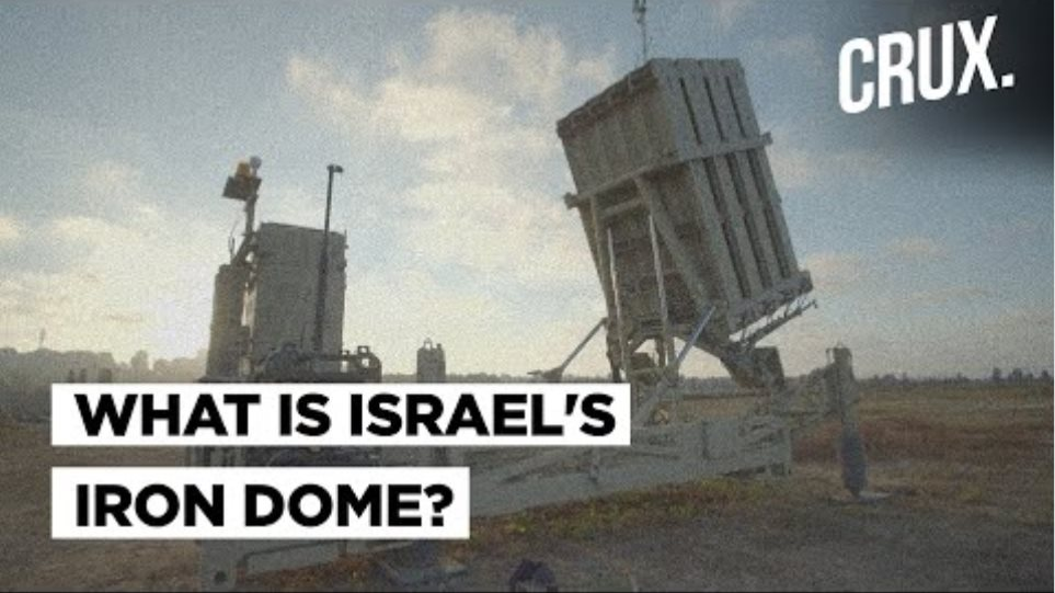 Israel's Iron Dome defence intercepts scores of Gaza rockets in skies above Tel Aviv